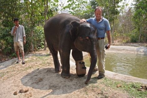 Chhouk and Nick next to Chhouks pool not long after Chhouk received his prosthetic foot